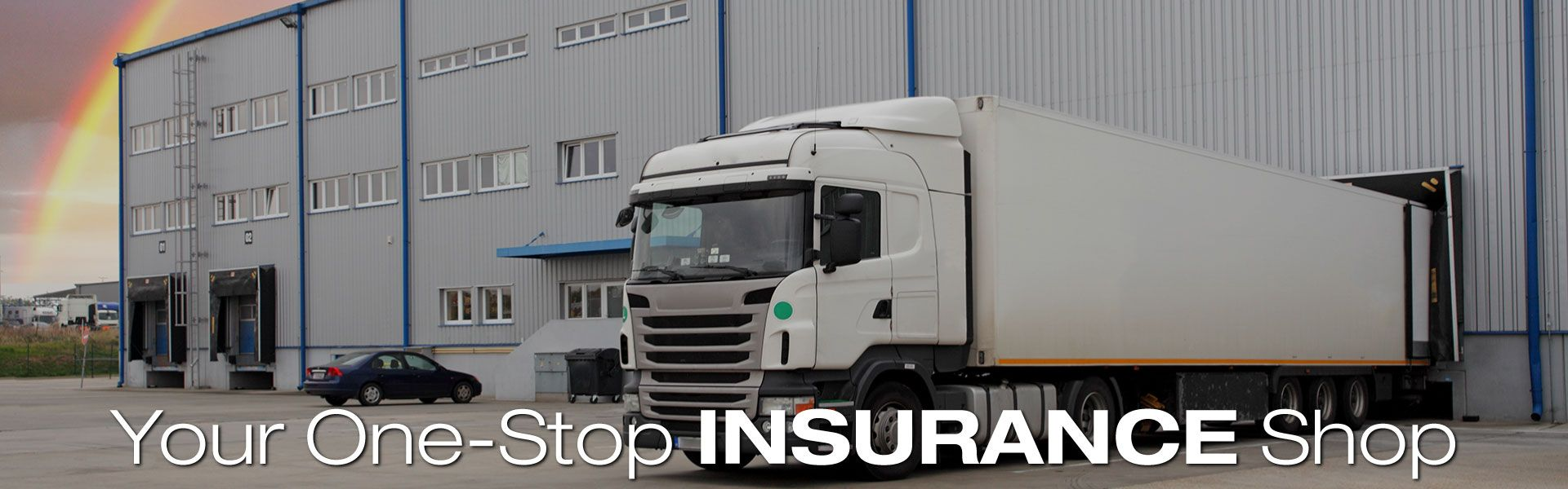 Your One-Stop Insurance Shop | Semi truck next to warehouse